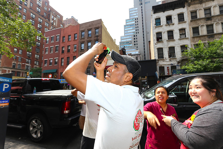 NEW YORK - AUGUST 21:  Crowds Gather As People Try and View The Full Total Eclipse On And Near 42nd Street By Grand Central August 21, 2017 in New York City.