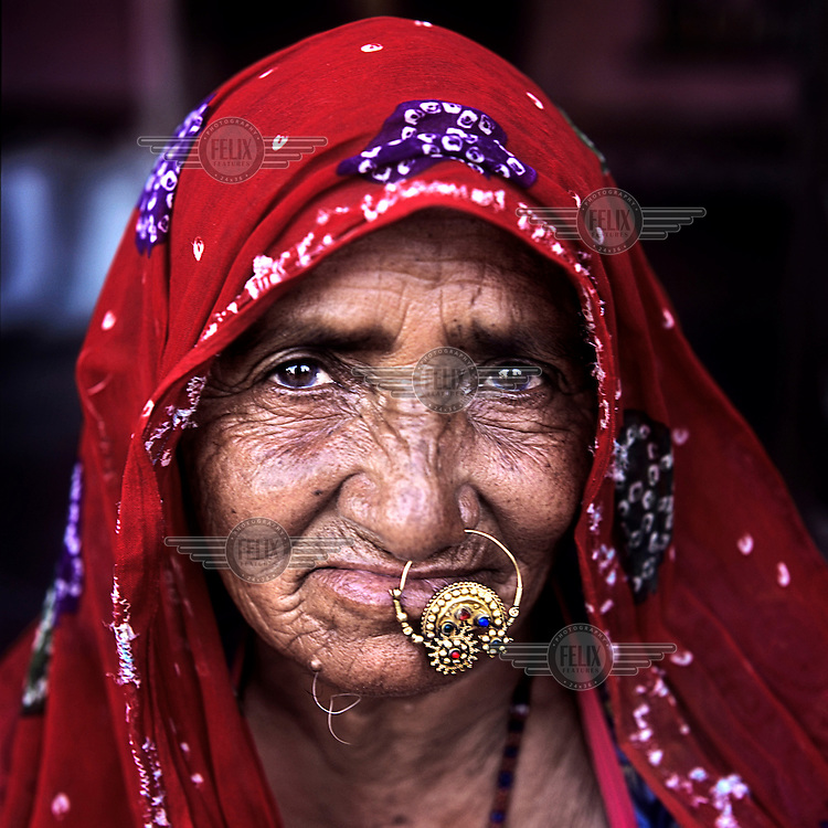 An elderly Raika woman. The Raika are an ancestral caste of camel breeders in Rajasthan. Due to the increased cost of feeding and shelter, more and more Raika are being forced to sell off their camels, often for camel meat, which was once considered taboo.