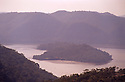 View of Peats Bite and Bar Island at junction of Berowra Creek and Hawkesbury River, Muogamarra Nature Reserve, Sydney. Hazy day.