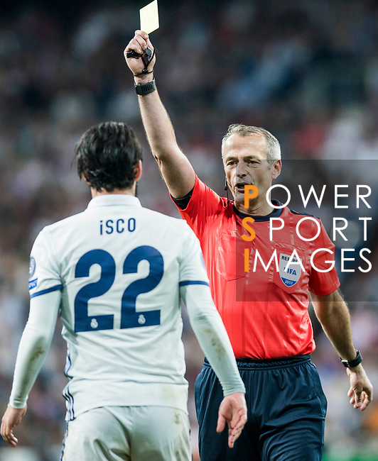 Referee Martin Atkinson shows Isco Alarcon of Real Madrid a yellow card during their 2016-17 UEFA Champions League Semifinals 1st leg match between Real Madrid and Atletico de Madrid at the Estadio Santiago Bernabeu on 02 May 2017 in Madrid, Spain. Photo by Diego Gonzalez Souto / Power Sport Images