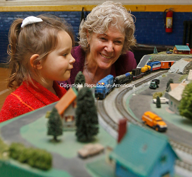 Torrington, CT-11 December 121215MK03 Quinn Cavallero and her grandmother Carla Landy watch the trains go by during the holiday model train show and canned food drive at the Torrington Armory. The free   annual event is hosted by the city and the Torrington Area Model Railroaders features layouts in HO and N scale trains.    The event will be open again today from 9 a.m. to 3 p.m. on Dec. 13.  Michael Kabelka / Republican-American