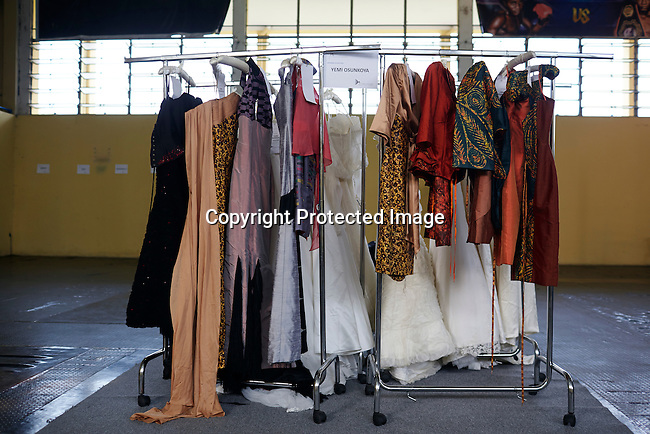 KINSHASA, DRC - JULY 17: Nigerian London based designer Yemi Osunkoya prepared his collection before a fitting a day before Kinshasa Fashion Week on July 17, 2014, at the boxing gym at Shark club in Kinshasa, DRC. (Photo by Per-Anders Pettersson)