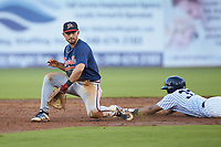 Danville Braves shortstop Beau Philip (4) tries to field a low throw as Robert Javier (33) of the Pulaski Yankees slides head first into second base at Calfee Park on June 30, 2019 in Pulaski, Virginia. The Braves defeated the Yankees 8-5 in 10 innings.  (Brian Westerholt/Four Seam Images)