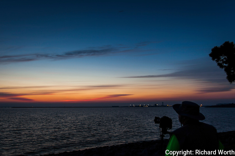 A photographer enjoying, savoring, capturing and documenting sunset from the east side of  San Francisco Bay.