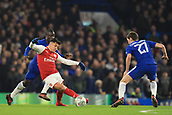 10th January 2018, Stamford Bridge, London, England; Carabao Cup football, semi final, 1st leg, Chelsea versus Arsenal; Alexis Sanchez of Arsenal takes on Andreas Christensen of Chelsea