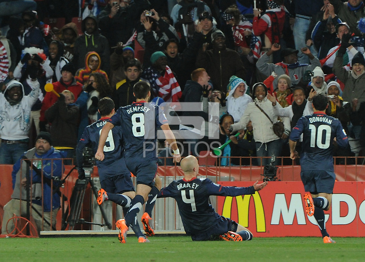 Michael Bradley and teammates celebrate his 82nd minute goal to pull the U.S. back level. The United States came from a 2-0 halftime deficit to Slovenia to earn a 2-2 draw their second match of play in Group C of the 2010 FIFA World Cup.