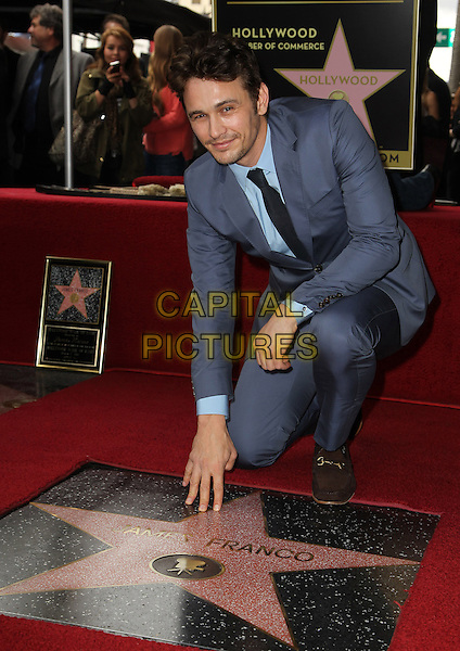 James Franco.James Franco Honored with Star on the Hollywood Walk of Fame, Hollywood, California, USA, 7th March 2013..full length kneeling hand leaning gray suit tie blue shirt .CAP/ADM/FS.©Faye Sadou/AdMedia/Capital Pictures.