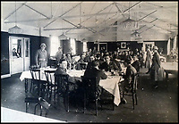 BNPS.co.uk (01202 558833)<br /> Pic:  PeterWilson/BNPS<br /> <br /> The airship crew pictured enjoying a formal meal.<br /> <br /> A charming letter which was carried on the first airship to cross the Atlantic has come to light 100 years later.<br /> <br /> Reverend George Jones, who was stationed at the Royal Naval Air Station East Fortune near Edinburgh, wanted to surprise his sister Donie by sending her a letter from America.<br /> <br /> So he gave the letter to one of the crew of airship R34 ahead of the historic flight on July 2, 1919, and asked him to post it to Donie from New York.<br /> <br /> He obliged and the letter reached its final destination in Bournemouth, Dorset, several months later as it made the return journey via ship.