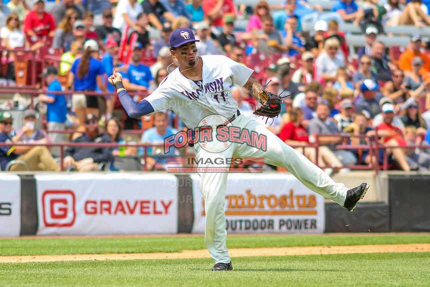 Wisconsin Timber Rattlers third baseman Gilbert Lara (11) makes a throw to first base during a Midwest League game against the Bowling Green Hot Rods on July 22, 2018 at Fox Cities Stadium in Appleton, Wisconsin. Bowling Green defeated Wisconsin 10-5. (Brad Krause/Four Seam Images)