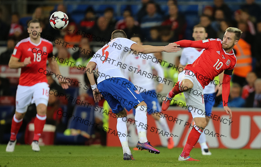 (copyright &amp; photo: STARSPORT)<br /> 12.11.16 - Wales v Serbia, FIFA World Cup Qualifier 2018 - Aaron Ramsey of Wales  and Matija Nastasic of Serbia compete for the ball