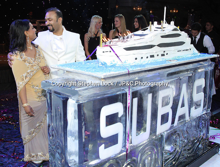 Lycamobile Chairman Subas Allirajah and his wife Prema with his yacht shaped birthday cake at his 40th birthday party held in London, Friday, 2nd March 2012.  Photo by: Stephen Lock / i-Images