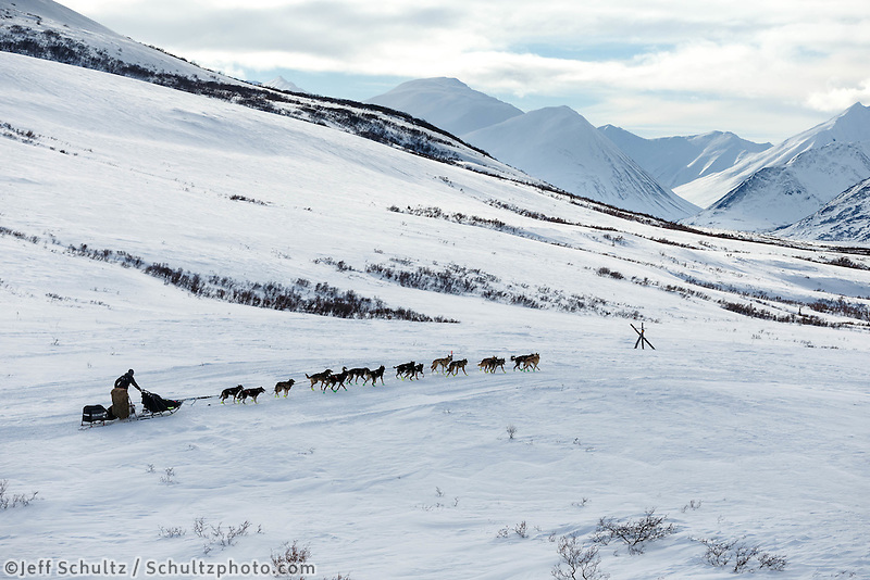 Richie Diehl on the trail in the Alaska Range in Ptarmigan Valley on the way to Rohn from the Rainy Pass checkpoint during Iditarod 2016.  Alaska.  March 07, 2016.  <br /> <br /> Photo by Jeff Schultz (C) 2016 ALL RIGHTS RESERVED