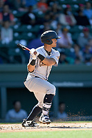 Shortstop WIlkerman Garcia (3) of the Charleston RiverDogs bats in a game against the Greenville Drive on Sunday, April 29, 2018, at Fluor Field at the West End in Greenville, South Carolina. Greenville won, 2-0. (Tom Priddy/Four Seam Images)