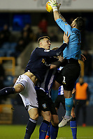 Sheffield Wednesday goalkeeper, Keiren Westwood, catches the ball under pressure from Millwall's Jake Cooper during Millwall vs Sheffield Wednesday, Sky Bet EFL Championship Football at The Den on 12th February 2019