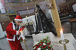 A Palestinian boy dressed up as Santa Claus lights a candel during Christmas eve mass in Gaza City, on December 24, 2010, a Christians around the world celebrate the birth of jesus Christ. Photo by Mohammed Asad