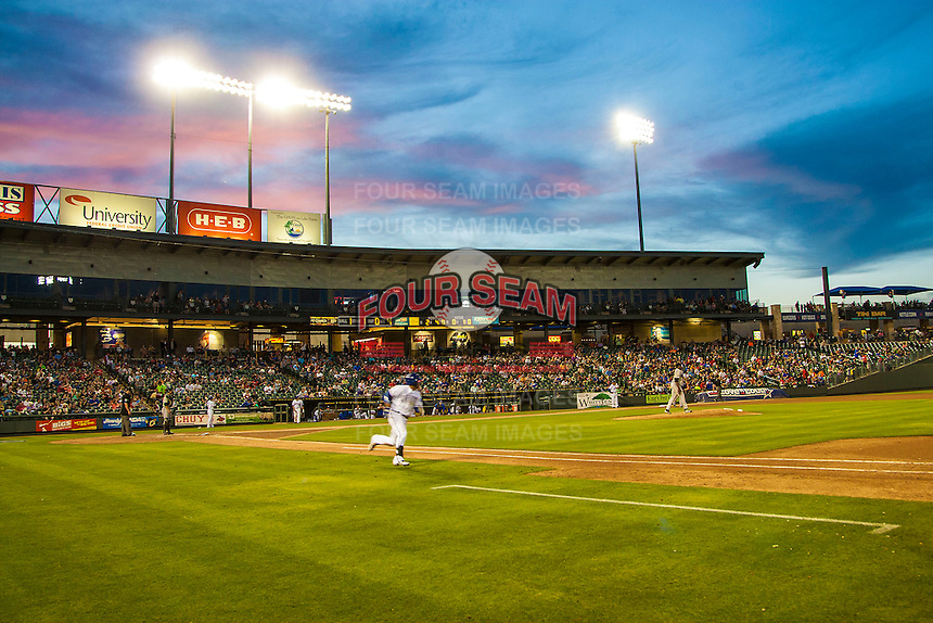 Sunset at the Dell Diamond during the Pacific Coast League baseball game against the Nashville Sounds on May 4, 2013 in Round Rock, Texas. Round Rock defeated Nashville -6. (Andrew Woolley/Four Seam Images).