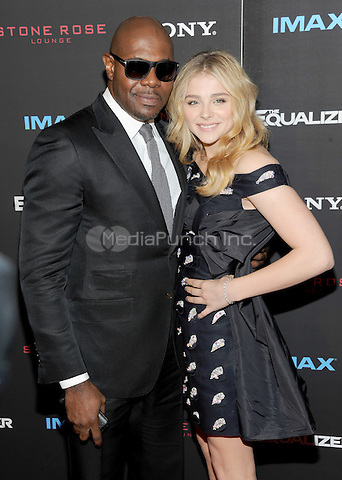 New York, NY-September 22: Director Antoine Fuqua and  Chloe Grace Moretz attends a special screening of The Equalizer at the AMC Lincoln Square 13 IMAX on September 22, 2014 in New York City.  Credit: John Palmer/MediaPunch