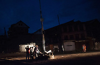 Srinagar, India-August 7, 2010: Kashmiri protesters awaits a military vehicle to ambush in downtown Srinagar during a curfew