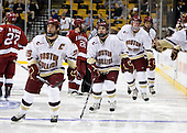 Matt Price (BC - 25), Barry Almeida (BC - 9), Brian Dumoulin (BC - 2) - The Boston College Eagles defeated the Harvard University Crimson 6-0 on Monday, February 1, 2010, in the first round of the 2010 Beanpot at the TD Garden in Boston, Massachusetts.