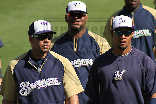 MARYVALE - March 2014: Aramis Ramirez, Juan Francisco and Carlos Gomez of the Milwaukee Brewers during a spring training workout on March 19th, 2014 at Maryvale Baseball Park in Maryvale, Arizona.  (Photo Credit: Brad Krause)