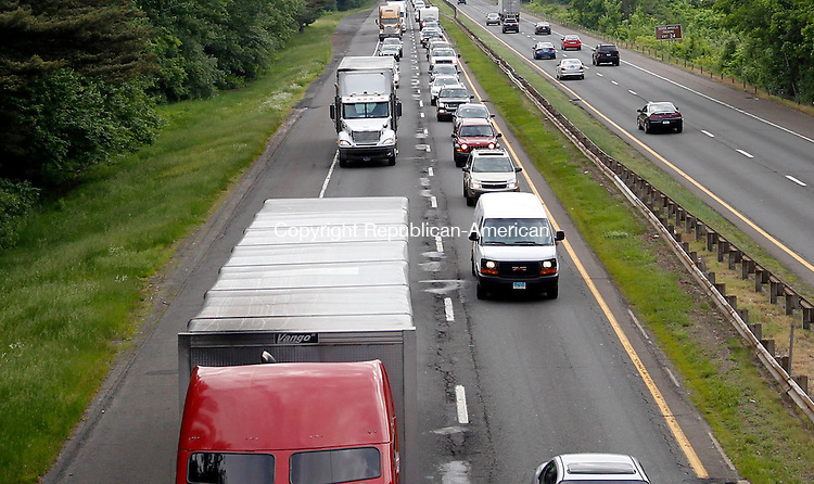 Waterbury, CT- 03 June 2013-060313CM08-  Traffic is backed up from Scott Road, heading east bound on I-84 in Waterbury Monday afternoon. A tractor-trailer accident occurred between exits 25 and 25A, forced. city firefighters and crews from the state Department of Energy and Environmental Protection to contain a diesel fuel spill of about 75 gallons from one of the rig's saddle tanks.     Christopher Massa Republican-American
