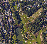 BNPS.co.uk (01202 558833)<br /> Pic:  GoogleMaps/BNPS<br /> <br /> Google Maps image showing gold course and tress before they were felled.<br /> <br /> A prestigious golf club that axed 34 protected trees has been ordered to plant new specimens in their place to compensate for the act of 'environmental vandalism'. <br /> <br /> Officials at Parkstone Golf Club in Poole, Dorset, must grow 13 'advanced' specimens of at least 10ft in height in the same spot the mature pine trees once stood.<br /> <br /> The club, that counts Harry Redknapp as a member, fell foul of a 56-year-old Tree Preservation Order (TPO) covering the 70ft tall trees when it cut them down in December 2018.<br /> <br /> The owners of £1m homes that back on to the course were furious as they said the trees provided shelter from the wind and privacy from golfers playing the 1st and 2nd holes.