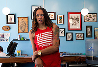 Jun. 10, 2013; Phoenix, AZ, USA: Phoenix Mercury center Brittney Griner inside the Golden Rule Tattoo shop in downtown Phoenix. Mandatory Credit: Mark J. Rebilas-
