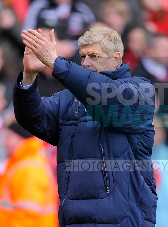 Arsene Wenger manager of Arsenal applauds the fans.Barclays Premier League match between Stoke City v Arsenal at The Brittannia Stadium, Stoke on the 28th April 2012..Sportimage +44 7980659747.picturedesk@sportimage.co.uk.http://www.sportimage.co.uk/.