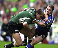 04/05/2002.Sport - Rugby Union.Zurich Premiership.London Irish vs Sale.Bryan Redpath tackles Justin Bishop...[Mandatory Credit, Peter Spurier/ Intersport Images].