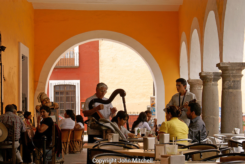 Musicians entertaining diners in a restaurant under the portales, Cholula, Puebla, Mexico. Cholula is a UNESCO World Heritage Site.