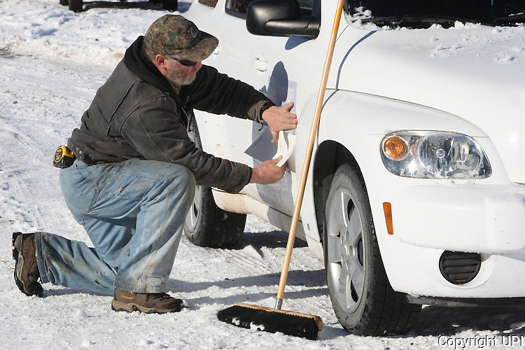 Activists Ken Medenbeck of Cresent, Oregon, changes signage on government vehicles at the Malheur National Wildlife Reserve on January 15, 2016 in Burns, Oregon.  Ammon Bundy and about 20 other protesters took over the refuge on Jan. 2 after a rally to support the imprisoned local ranchers Dwight Hammond Jr., and his son, Steven Hammond.      Photo by Jim Bryant/UPI