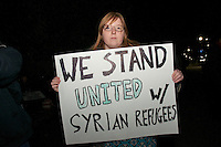 Rally in support of welcoming refugees and condemning Governor Baker in front of MA statehouse Bostson MA 11.20.15