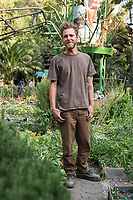 Joshua Nichols, a volunteer at the Urban community garden project Roma Verde, Colonia Roma, Mexico City, Mexico