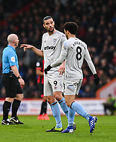 West Ham United's Andy Carroll (left) chatting to team mate West Ham United's Felipe Anderson <br /> <br /> Photographer David Horton/CameraSport<br /> <br /> The Premier League - Bournemouth v West Ham United - Saturday 19 January 2019 - Vitality Stadium - Bournemouth<br /> <br /> World Copyright © 2019 CameraSport. All rights reserved. 43 Linden Ave. Countesthorpe. Leicester. England. LE8 5PG - Tel: +44 (0) 116 277 4147 - admin@camerasport.com - www.camerasport.com