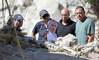 Pictured: Eddie Needham (C), the grandfather of missing Ben Needham with South Yorkshire Police officers in Kos, Greece. Wednesday 05 October 2016<br /> Re: Police teams led by South Yorkshire Police, searching for missing toddler Ben Needham on the Greek island of Kos have moved to a new area in the field they are searching.<br /> Ben, from Sheffield, was 21 months old when he disappeared on 24 July 1991 during a family holiday.<br /> Digging has begun at a new site after a fresh line of inquiry suggested he could have been crushed by a digger.