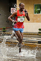 An athlete is hydrated, during the 32nd Mexico City International Marathon held in Mexico City, capital of Mexico, on Aug. 31, 2014. The Mexico City Marathon is a Boston Marathon qualifier. Photo by Miguel Angel Pantaleon/VIEWpress