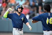 Second baseman Michael Paez (3) of the Columbia Fireflies is greeted by Luis Carpio (18) after hitting a home run in a game against the Greenville Drive on Thursday, June 15, 2017, at Fluor Field at the West End in Greenville, South Carolina. Columbia won, 7-2. (Tom Priddy/Four Seam Images)