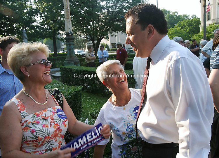 WATERBURY, CT 6/25/07- 062607BZ05- Anna DeSimone, of Watertown, and Rachele Puccinello, of Naugatuck, greet their nephew Rep. Anthony D'Amelio, R-71st District, before he announced his candidacy for Mayor of the City of Waterbury in front of City Hall Tuesday.<br /> Jamison C. Bazinet Republican-American