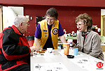 Winsted, CT- 24 March 2013-032413CM01-  Tom Beaudin, left, of New Hartford and his wife Marlene chat with Lion's Club member and event chairwoman Blanche Sewell, center, during the annual Winsted Lion's Club Palm Sunday Family Breakfast Sunday morning at the Pearson School in Winsted.  About 100 plates were served during the event, with proceeds going towards the purchase of glasses, hearing aids, scholarships for local students as well as helping out many local charities.  15 volunteers from the Lion's Club helped with the breakfast, just one of the many event's put on by the Lion's Club throughout the year.     Christopher Massa Republican-American