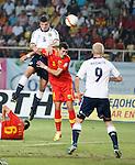 Grant Hanley powers a header on goal