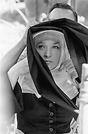 "Mexico, 1969. Actress Shirley MacLaine wearing a nun's costume on the movie set of the American 1970 western film ""Two Mules for Sister Sara"" directed by Don Siegel. Actor Clint Eastwood starred as the cowboy Hogan and Maclaine starred as Sister Sara in the comedy."