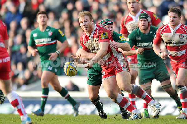 Matt Kvesic offloads the ball after being tackled. Aviva Premiership match, between Leicester Tigers and Gloucester Rugby on February 16, 2014 at Welford Road in Leicester, England. Photo by: Patrick Khachfe / JMP
