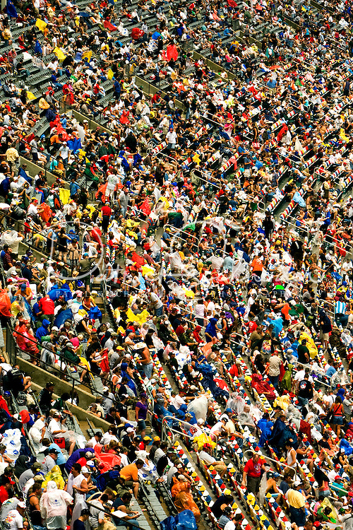 Die-hard NASCAR fans wait out the rain at the Lowe's Motor Speedway, in Concord, NC, during the 2009 Coca-Cola Classic 600 NASCAR race. Driver David Reutimann won his first Cup race during the rain-shortened event, held May 25, 2009. NASCAR's longest scheduled race went only 227 laps, or 340.5 miles, before officials ended it because of rain. The 2009 race was the 50th running of the Coca-Cola 600. Ryan Newman and Robby Gordon finished second and third respectively.
