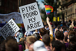 "© Joel Goodman - 07973 332324 . 23/08/2014 .  Manchester , UK . Placard reading "" Pink pound my arse "" . The parade through Manchester City Centre . Manchester Pride "" Big Weekend "" in Manchester "" today ( 23rd August 2014 ) . Photo credit : Joel Goodman"