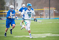 Eric Backus,'17, moves into position as the Seahawks battle Roger Williams in Men's Lacrosse game action at Gaudet Field in Middletown. as the Seahawks battle Roger Williams in Men's Lacrosse game action at Gaudet Field in Middletown.