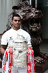 International rugby player of Sri Lankan from the Top 5 nations competing in this year's HSBC Asian 5 Nations poses with the tournament trophy near the iconic HSBC lion on January 19, 2011 in Hong Kong, China. Japan is the defending champions. Photo by Victor Fraile