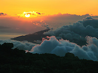 View of the setting sun from HALEAKALA NATIONAL PARK on Maui in Hawaii