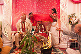 MAURITIUS, MAURITIUS, under a sheet Konydev prepares to apply orange dye to Anishtah forehead, announcing she's married, a Hindu wedding in the town of Surina