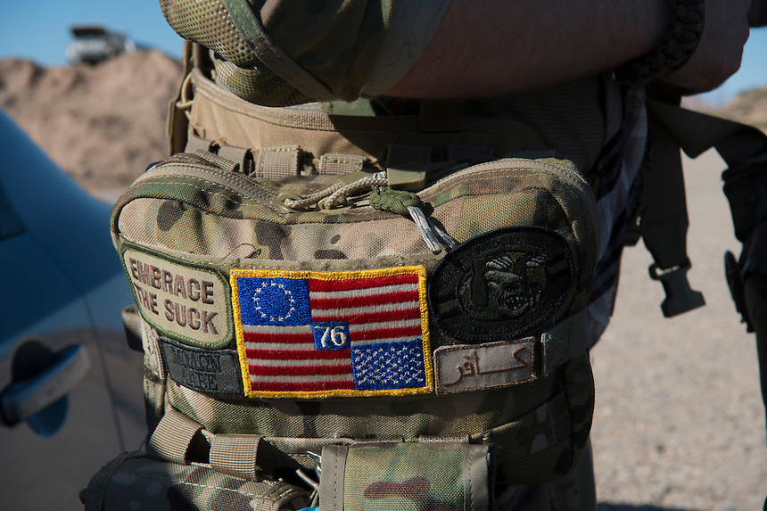 A militia member's pack adorned with &quot;EMBRACE THE SUCK&quot; and, in Arabic, &quot;Infidel&quot; at camp &quot;Liberty&quot; near the Cliven Bundy ranch in Bunkerville, Nevada.<br />