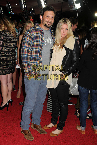 "Jeremy Sisto & guest .Attending the ""Scary Movie 5"" Los Angeles film premiere held at the Cinerama Dome,  Hollywood, California, USA, .11th April 2013..full length jeans beard facial hair grey gray plaid checked shirt .CAP/ADM/BP.©Byron Purvis/AdMedia/Capital Pictures"